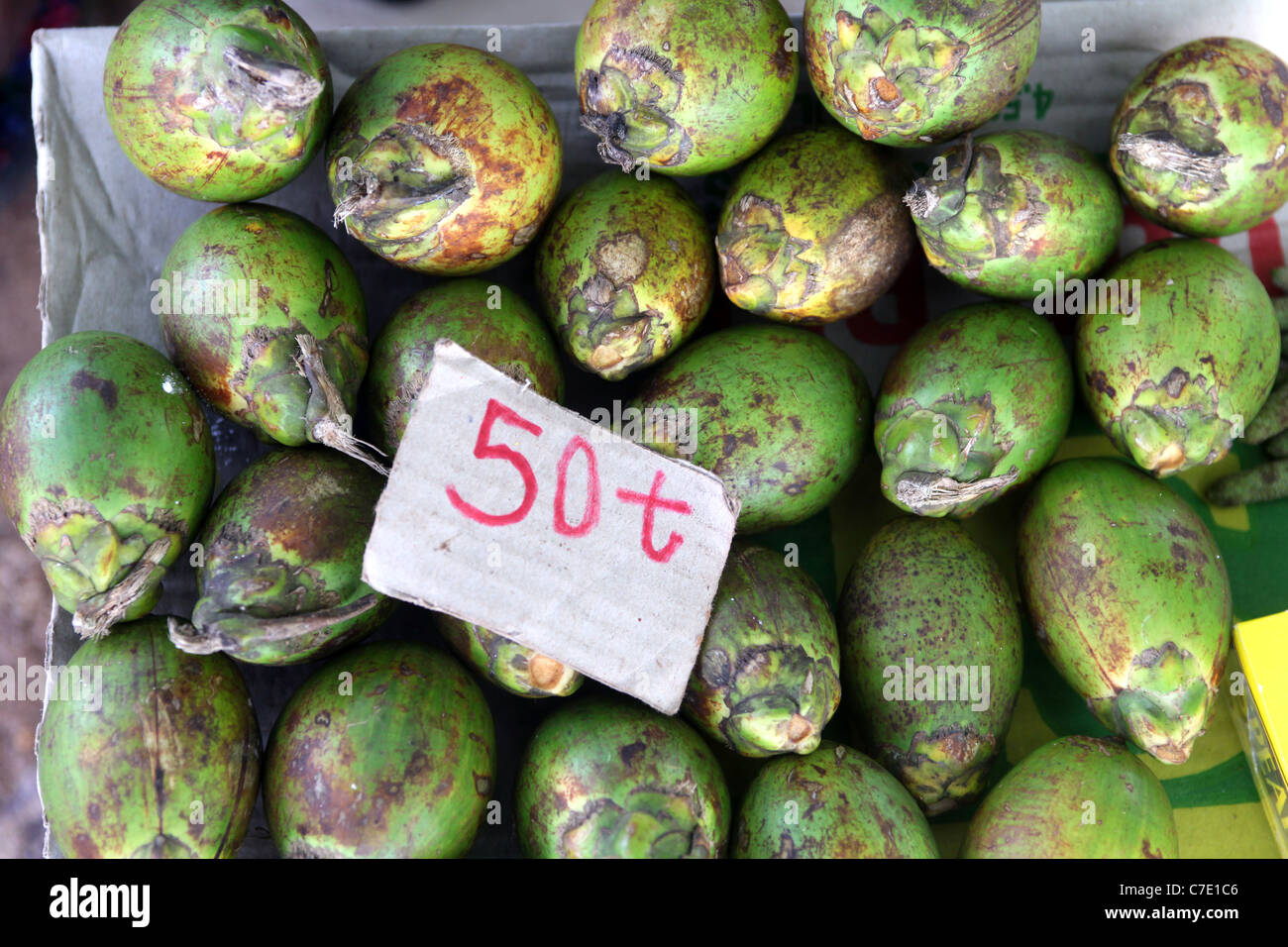 Betel nut for sale, with 50 Toea sign (0,5 Kina, cost of one nut). Papua New Guinea - Stock Image