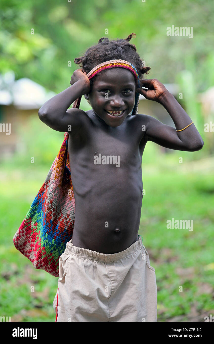 Boy with woven bilum hanging from his head. Bougainville Island, Papua New Guinea - Stock Image