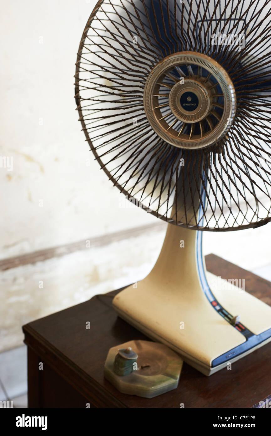 Fan in hot room Havana Cuba - Stock Image
