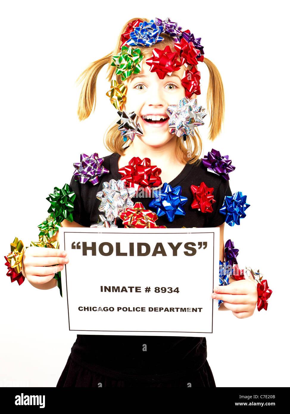 Christmas Bandit, girl with bows and ribbons - Stock Image
