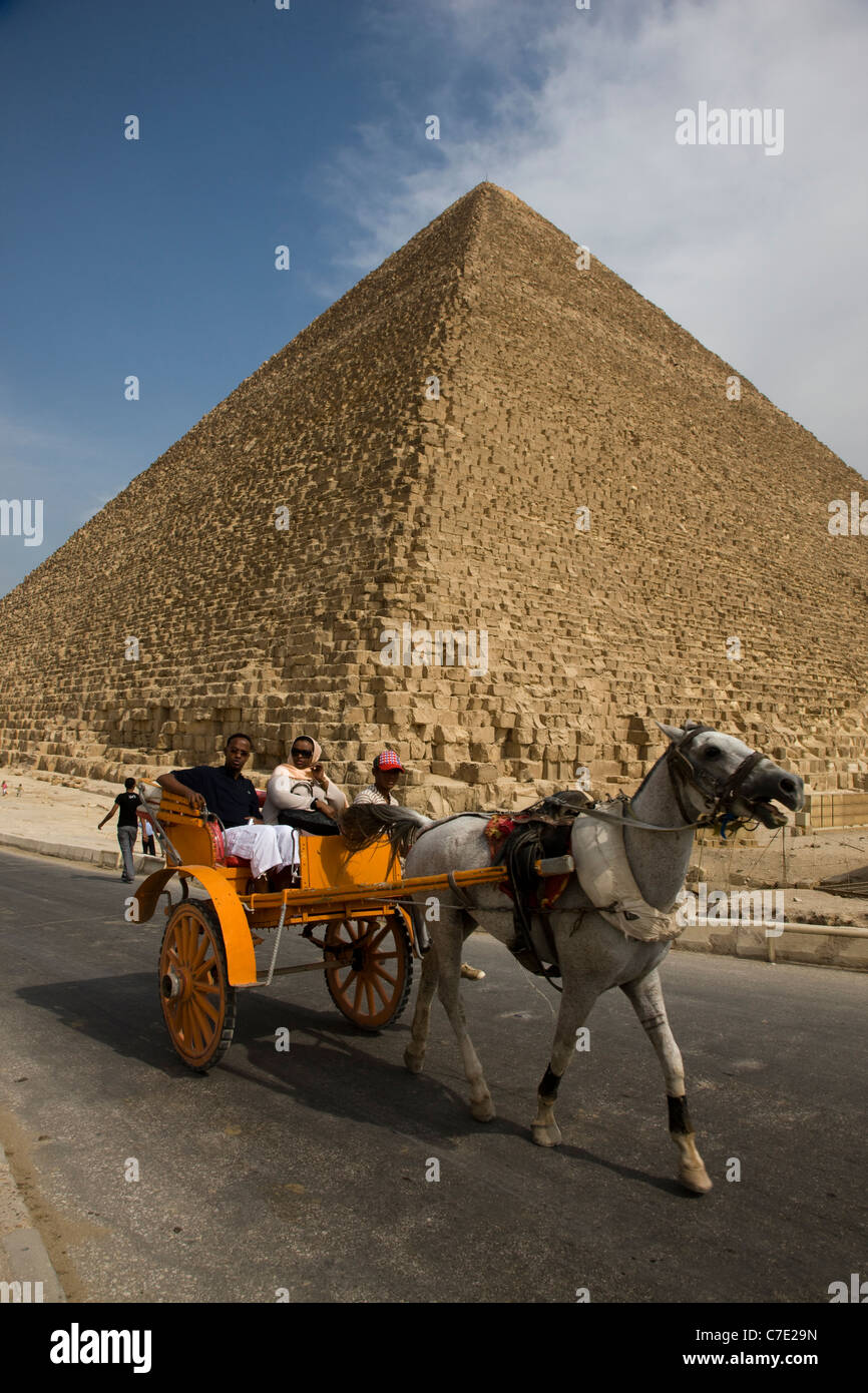 Horse and carriage ride in front of the pyramids at Gisa - Stock Image
