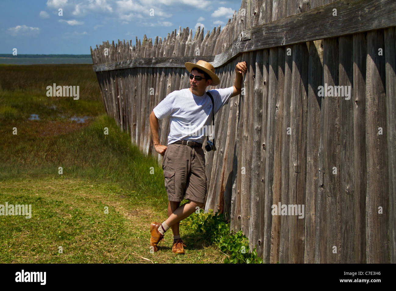 Man leaning against fence at Fort Fisher, North Carolina - Stock Image