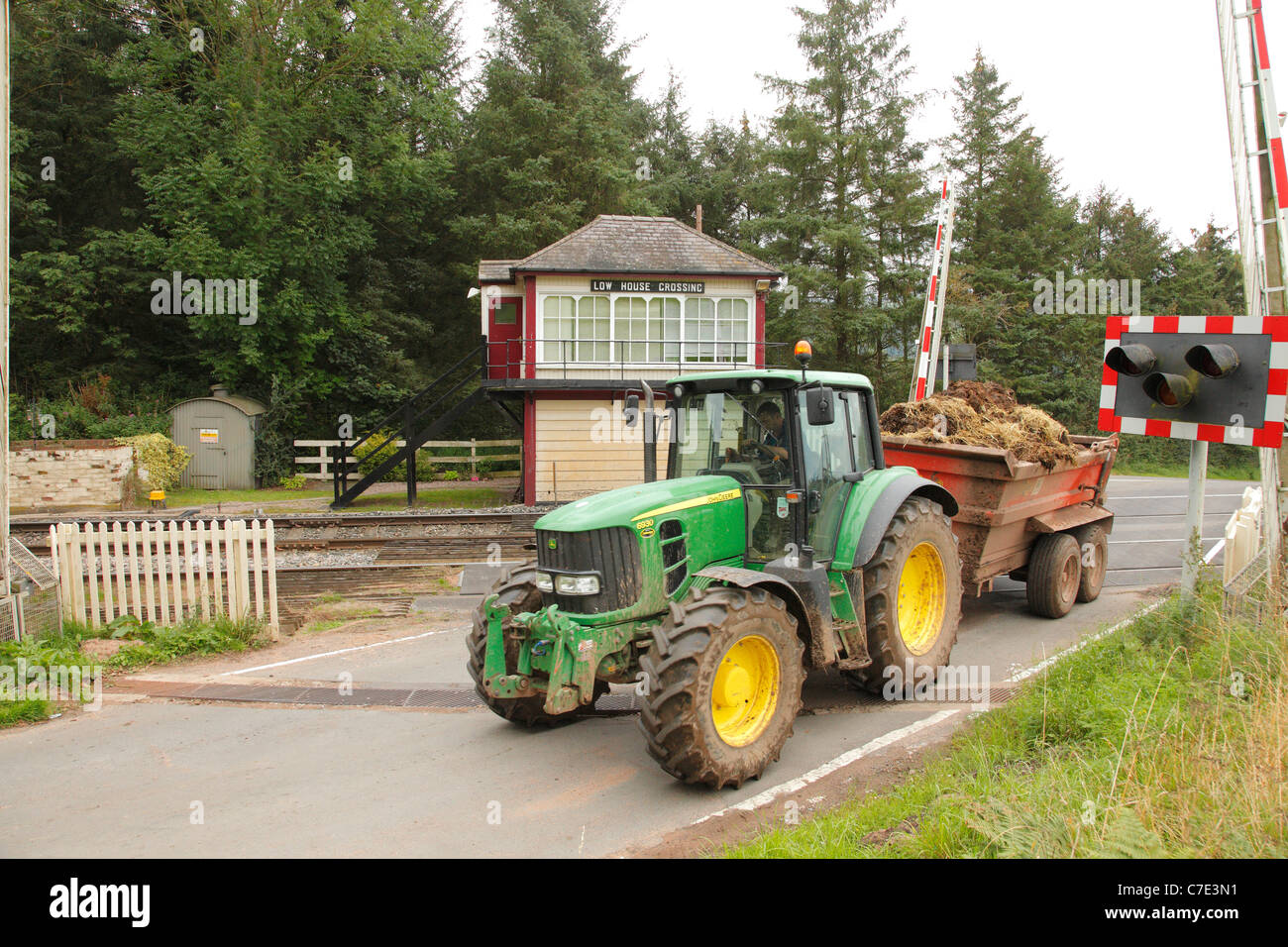 Tractor at Low House level crossing, Armathwaite, Settle to Carlisle Railway in the Eden Valley, Cumbria, England, - Stock Image