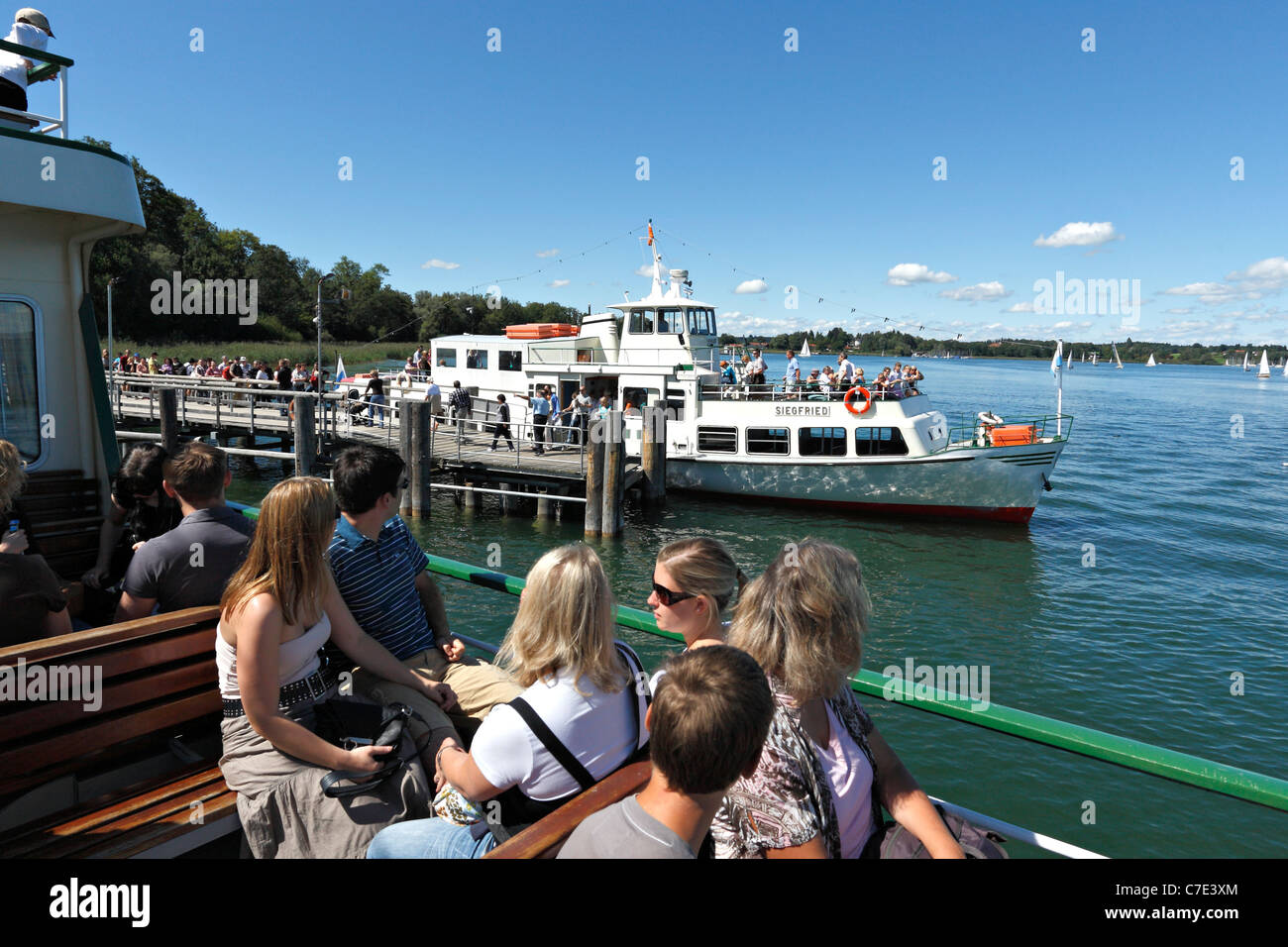 Passengers on a Chiemsee Ferry Boat at the Herreninsel, Chiemgau Upper Bavaria Germany - Stock Image