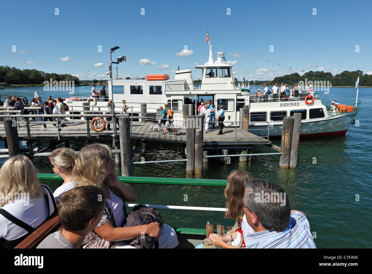 Passengers on a Chiemsee Ferry Boat at the Herreninsel, Chiemgau Upper Bavaria Germany Stock Photo
