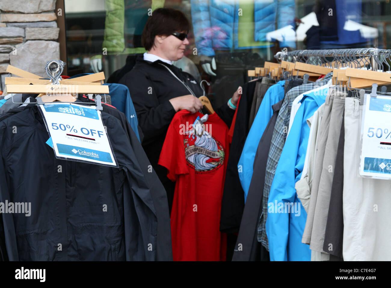 woman apparel clothes sale sales discount rack - Stock Image