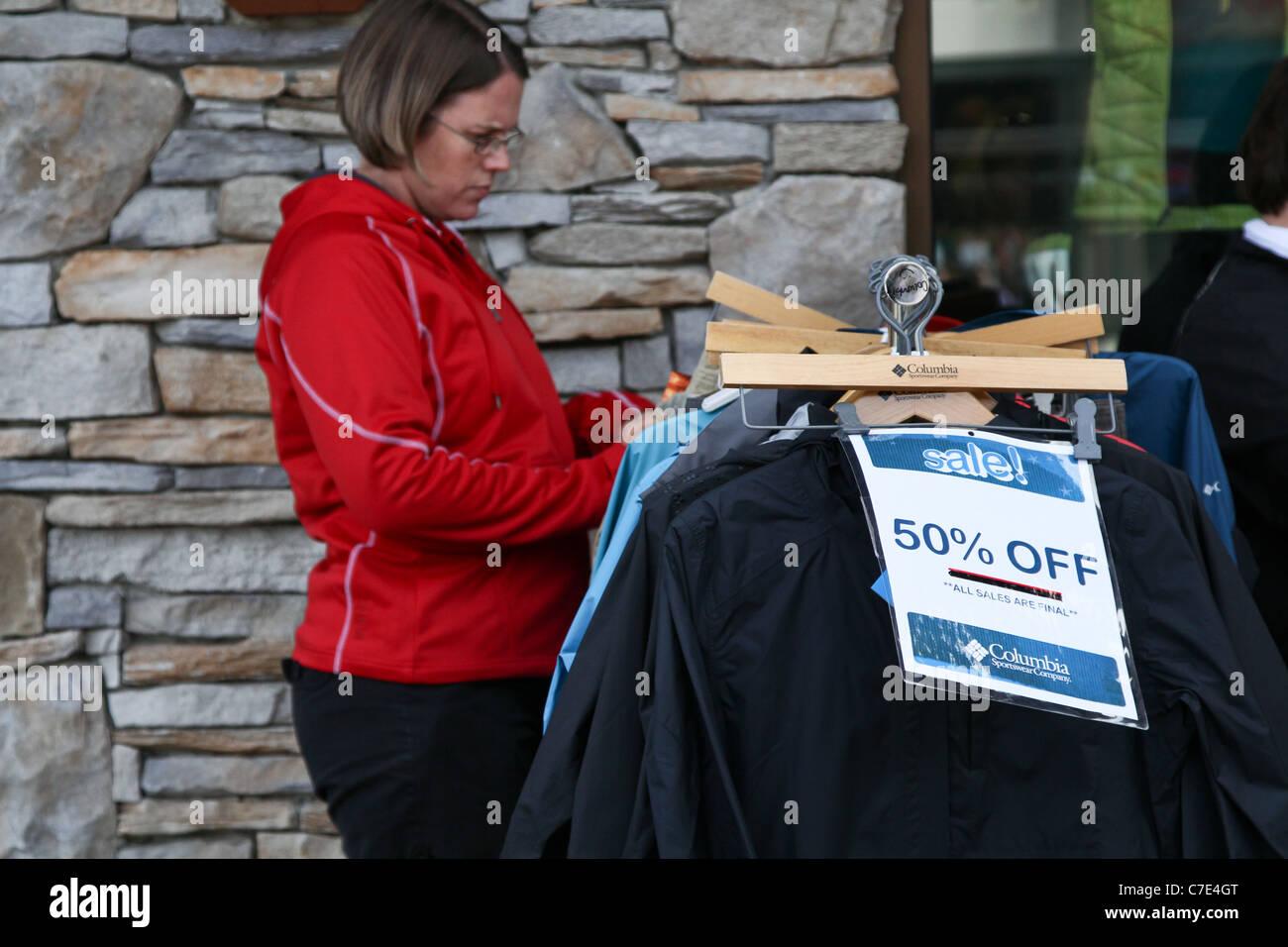 shopper apparel clothes sale sales discount rack - Stock Image