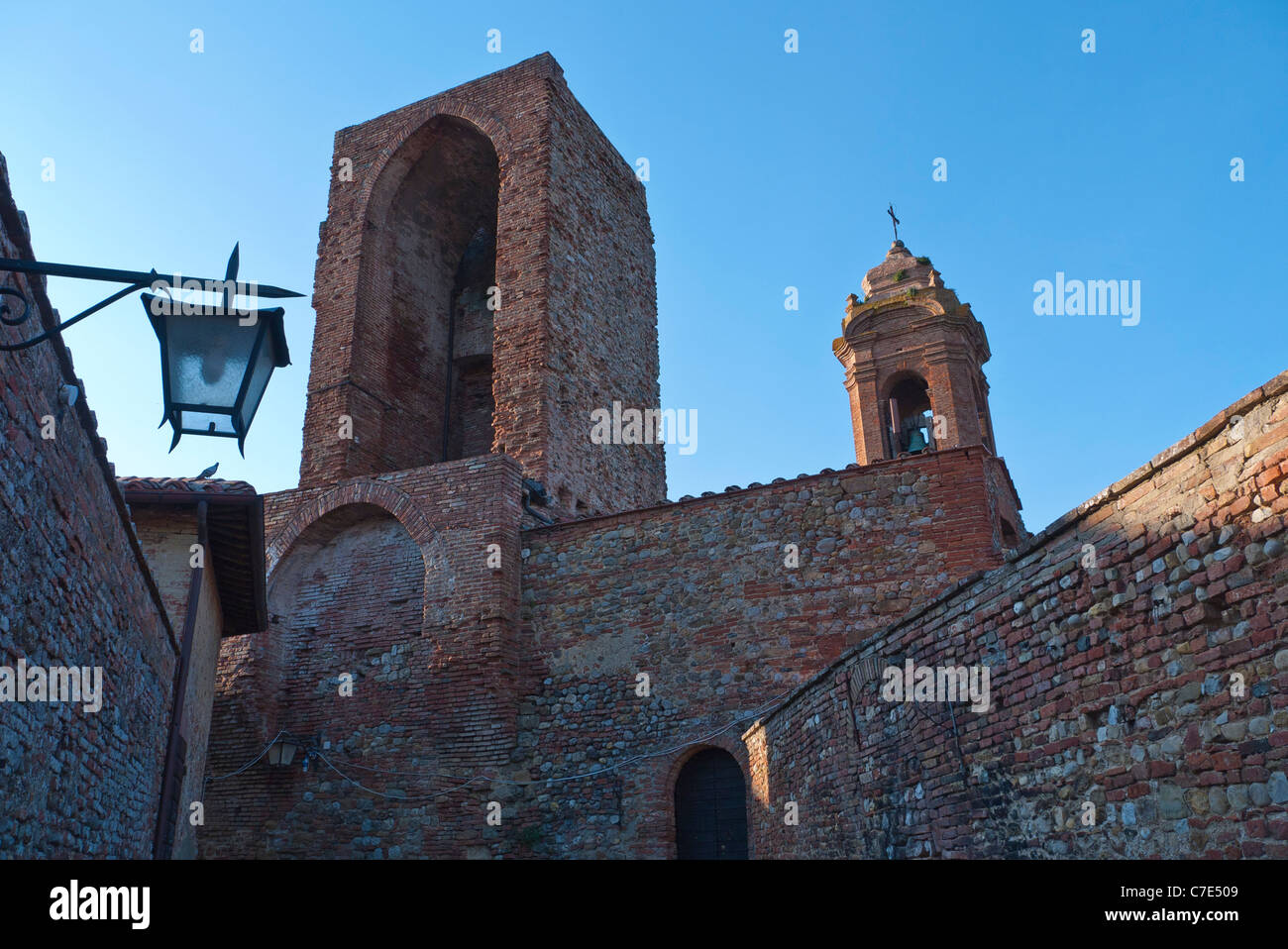 Exterior image of an ancient bell tower building in the medieval walled Umbrian town of Citta della Pieve, Italy. - Stock Image
