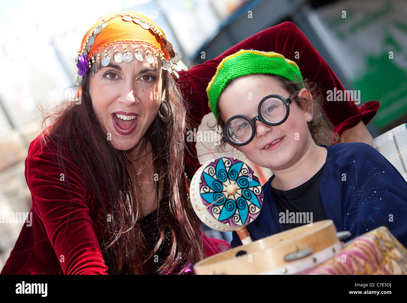 Fortune teller Rachel Hanaver with seven year-old Brooke Joseph at the Cardiff Bay Harbour Festival. - Stock Image