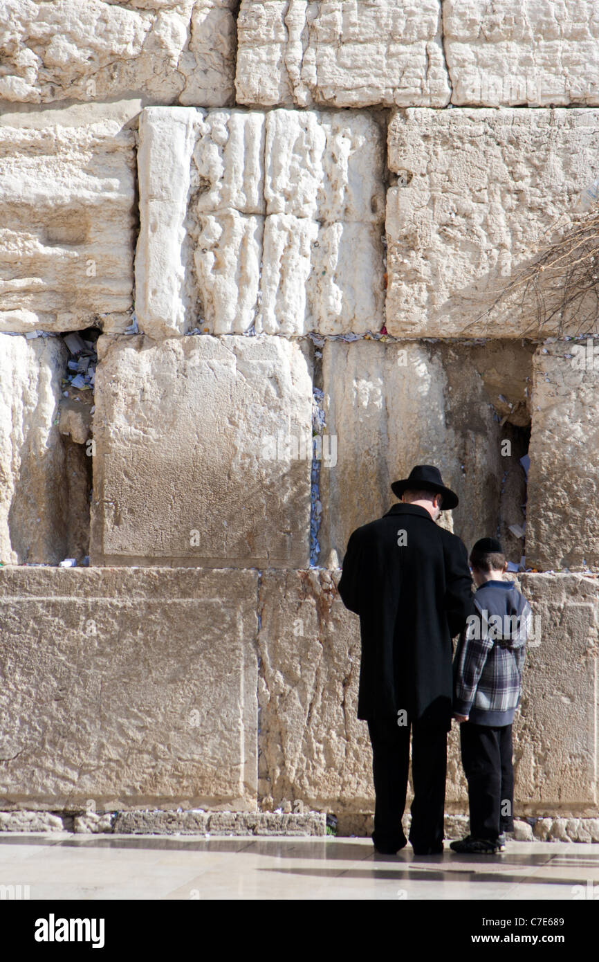 Jewish father and son praying at the Wailing Wall in Jerusalem, Israel - Stock Image
