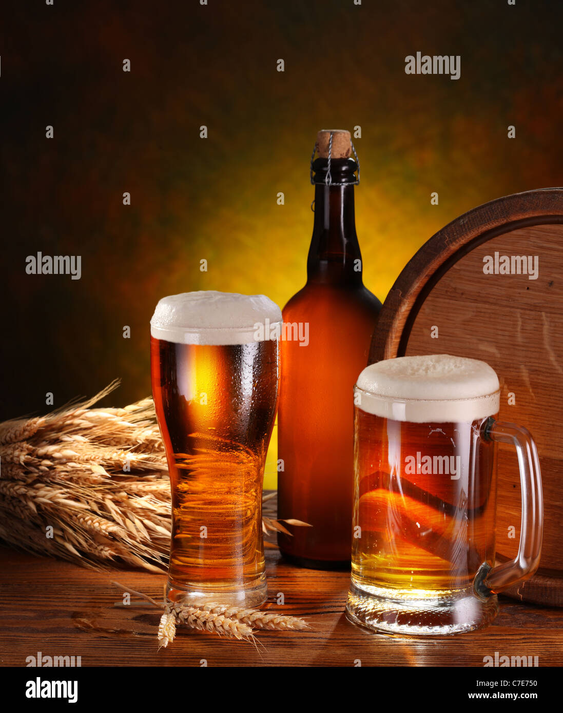 Still Life with a keg of beer and draft beer by the glass. - Stock Image