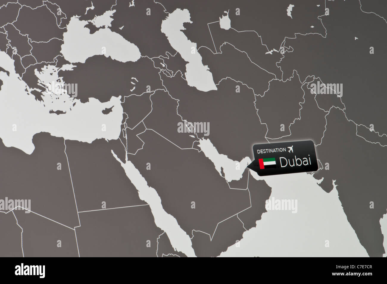 A close-up of a computer display indicating the location of Dubai International Airport, United Arab Emirates. - Stock Image