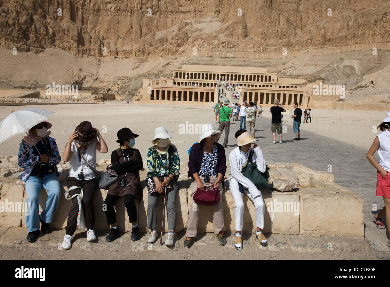 Japanese tourists wearing surgical face masks at the Temple of Hatshepsut, Luxor, Egypt Stock Photo