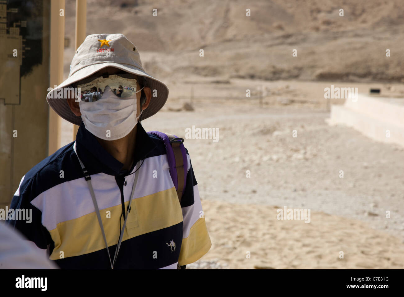 A Japanese tourist with face mask at the temple of Hatshepsut, Luxor, Egypt Stock Photo