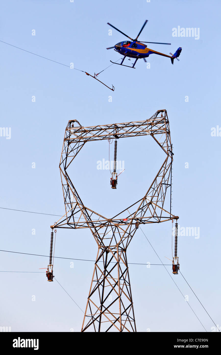 Helicopter threading the needle for the center phase - Stock Image