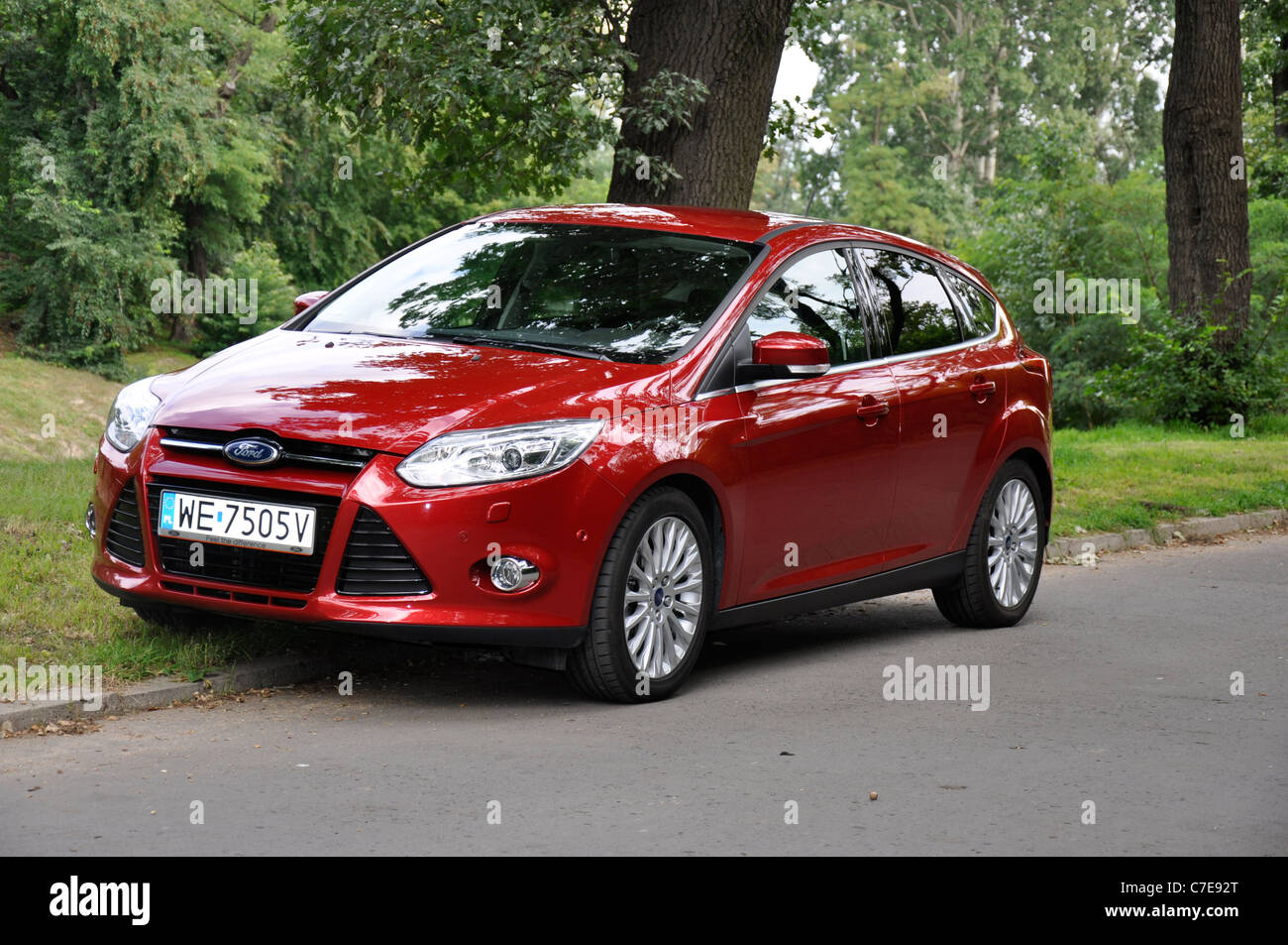 Ford focus iii 1 6 tdci my 2011 red popular german compact car segment c on park
