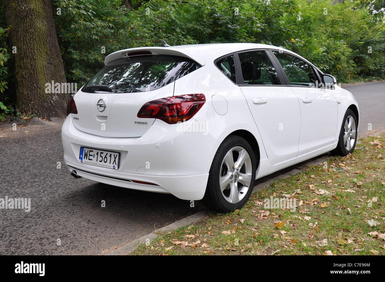 Opel Astra Iv 1 4 Turbo My 2009 White German Compact Car Stock Photo Alamy