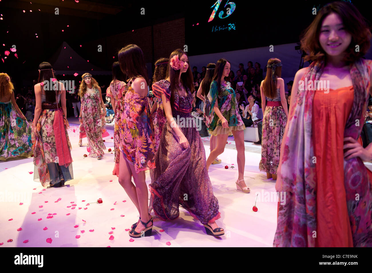 Models wearing Chinese brand Ayou walks during a fashion show in Beijing, China. - Stock Image