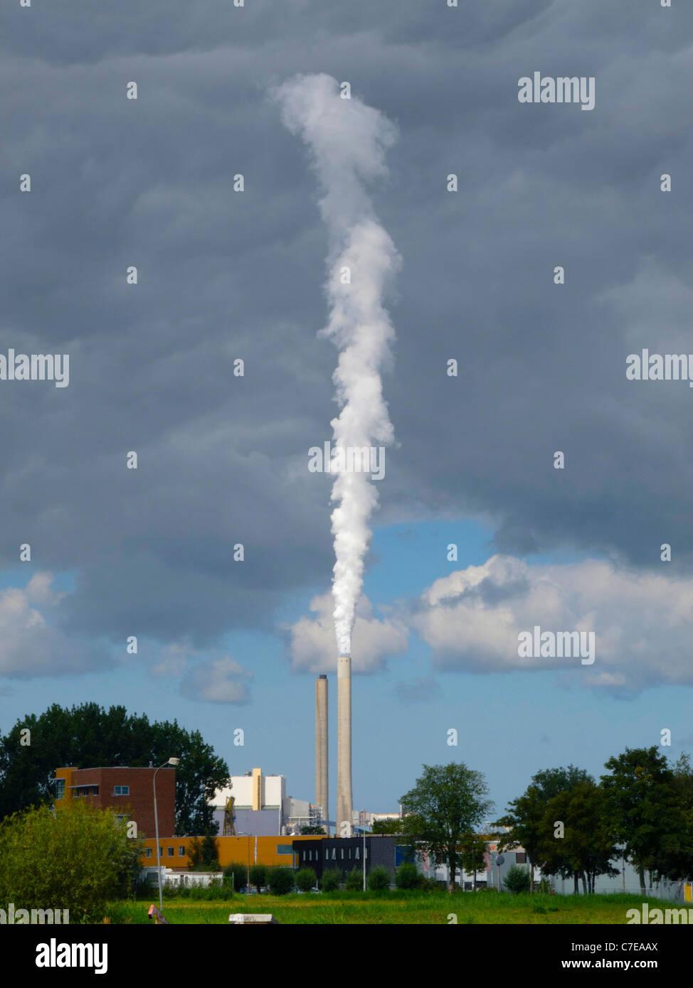 Smoke, steam from Hemweg Centrale, the main powerplant from Amsterdam. - Stock Image