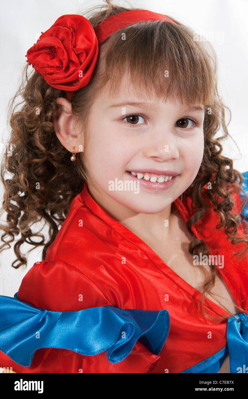 Portrait of the little girl dancer to a white background - Stock Image