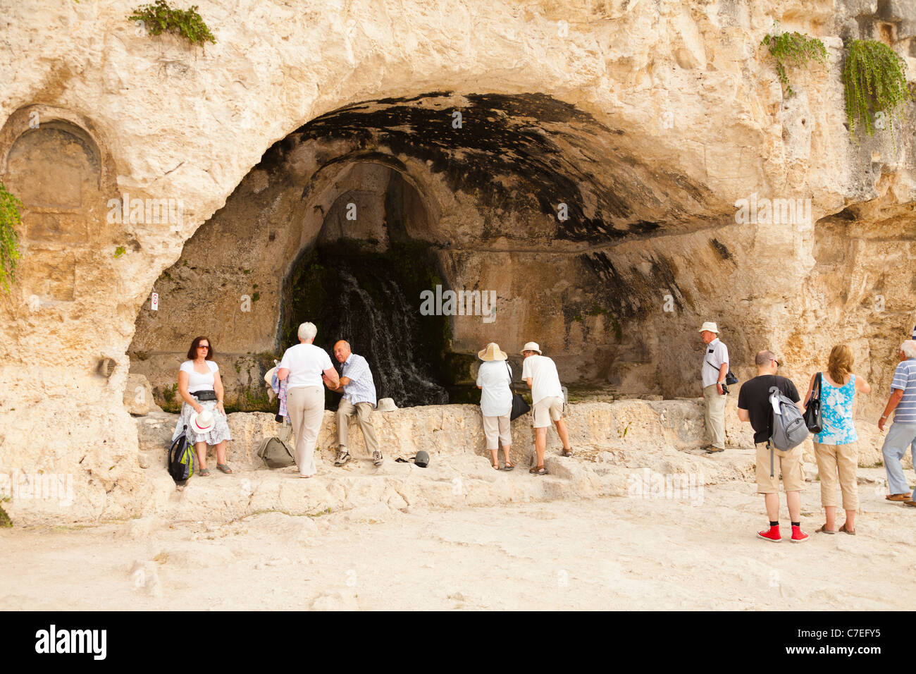 Grotta del Museion, located above the Greek Theatre, Neapolis Archaeological Park, Syracuse, Sicily, Italy - Stock Image