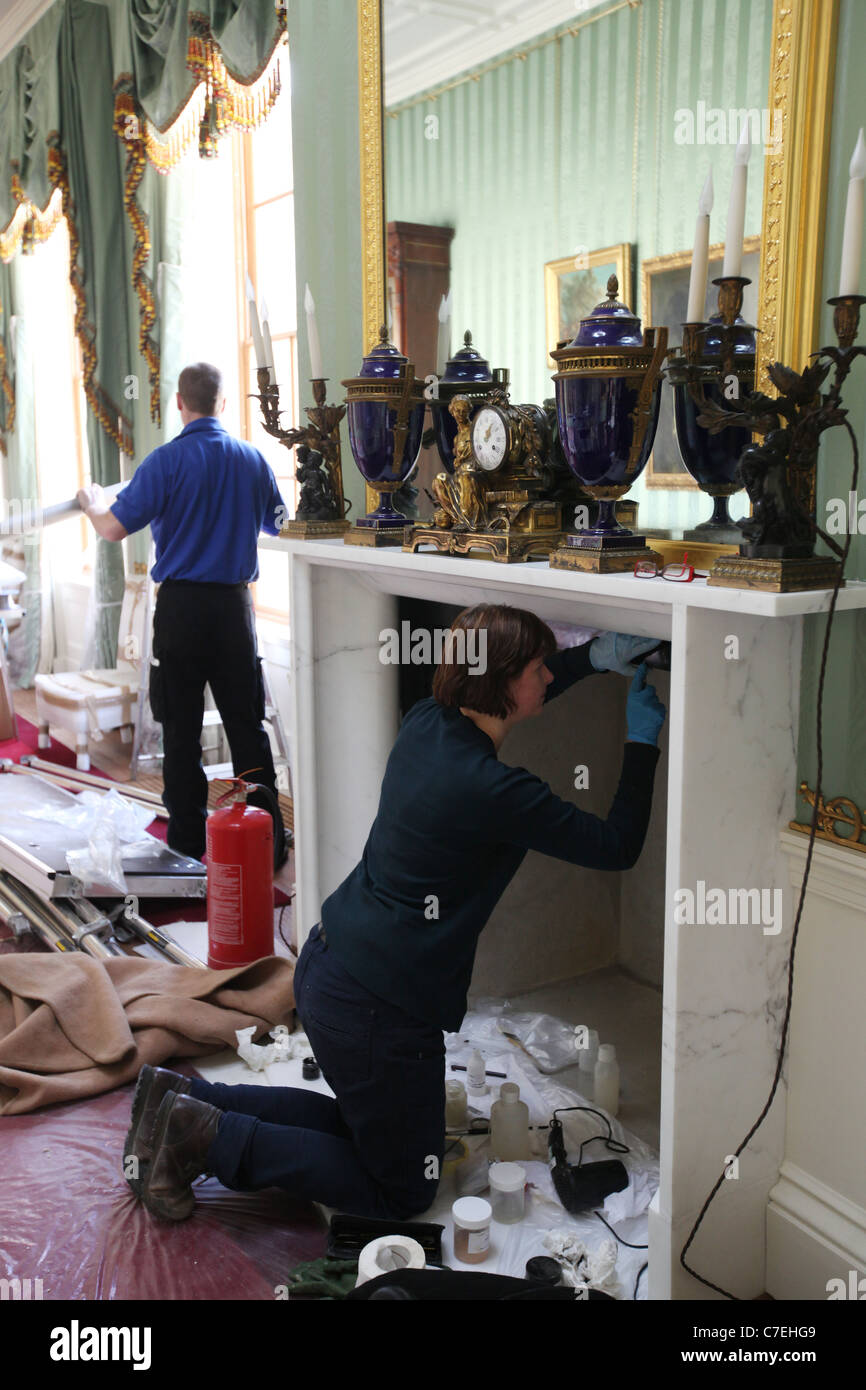 Chatsworth House in Derbyshire which is to re-open after an extensive facelift. Pictured is a workman adding finishing Stock Photo
