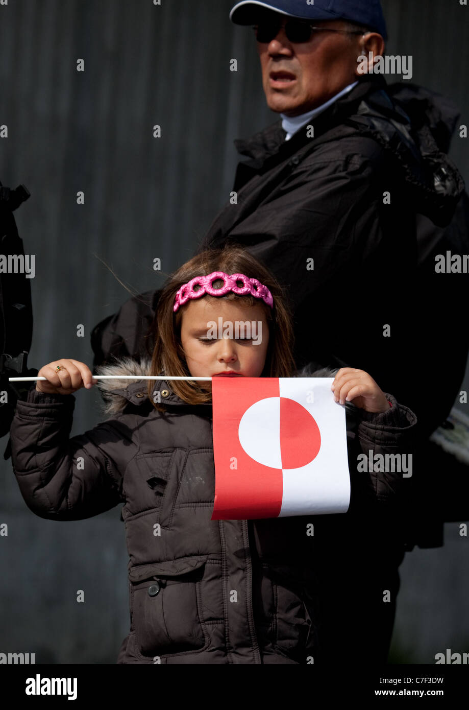 Little girl holding Greenland flag, National Day, celebrating Self-government, Nuuk, Greenland. - Stock Image
