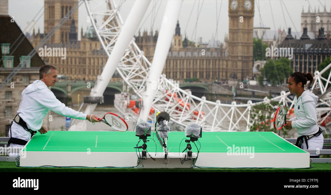 Gary Lineker challenges Xperia Hot Shot Heather Watson to a game of Sony Ericsson's Tennis in the Sky on a specially - Stock Image