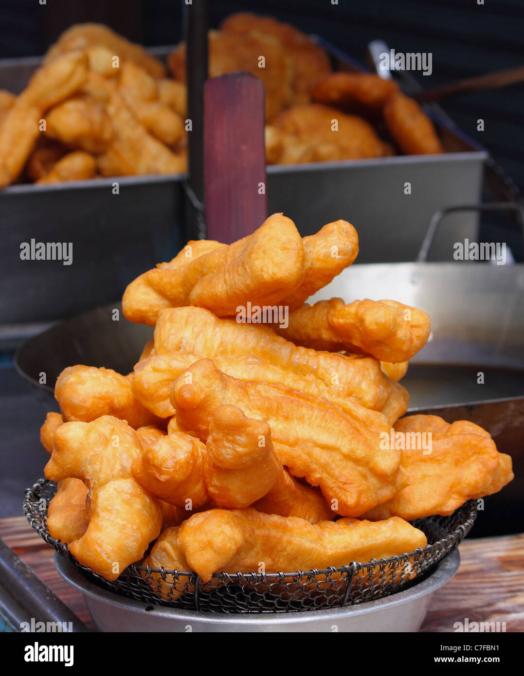 Fried flour stick is typical  Thai-Chinese food in Thailand ,Usually have in the morning but now throughout the - Stock Image