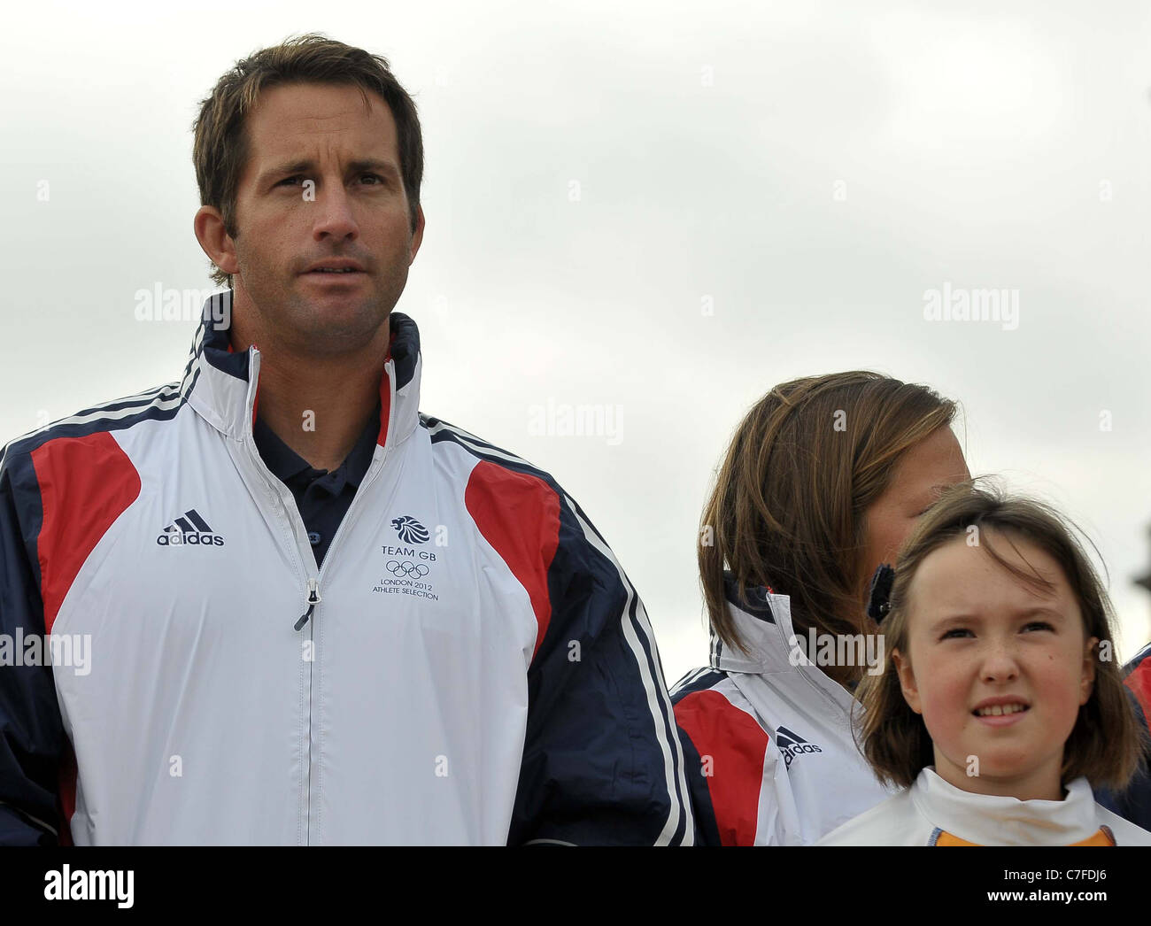 Ben Ainslie CBE and one of the local school children. TeamGB announces the first athletes to be selected for the - Stock Image