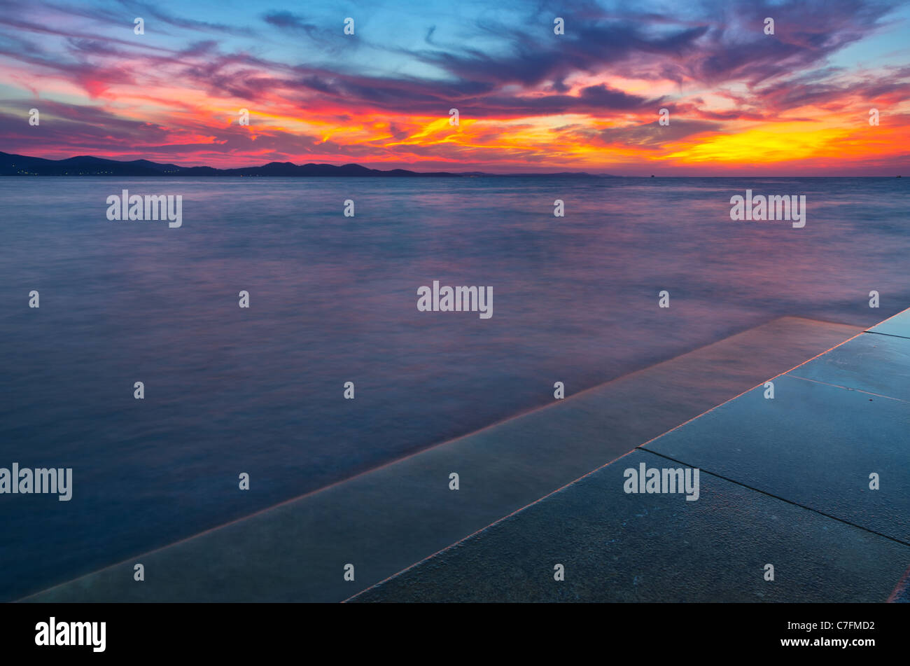 Zadar's famous Sea organs, and the sunset. One great evening in town Zadar, Adriatic, Croatia. - Stock Image