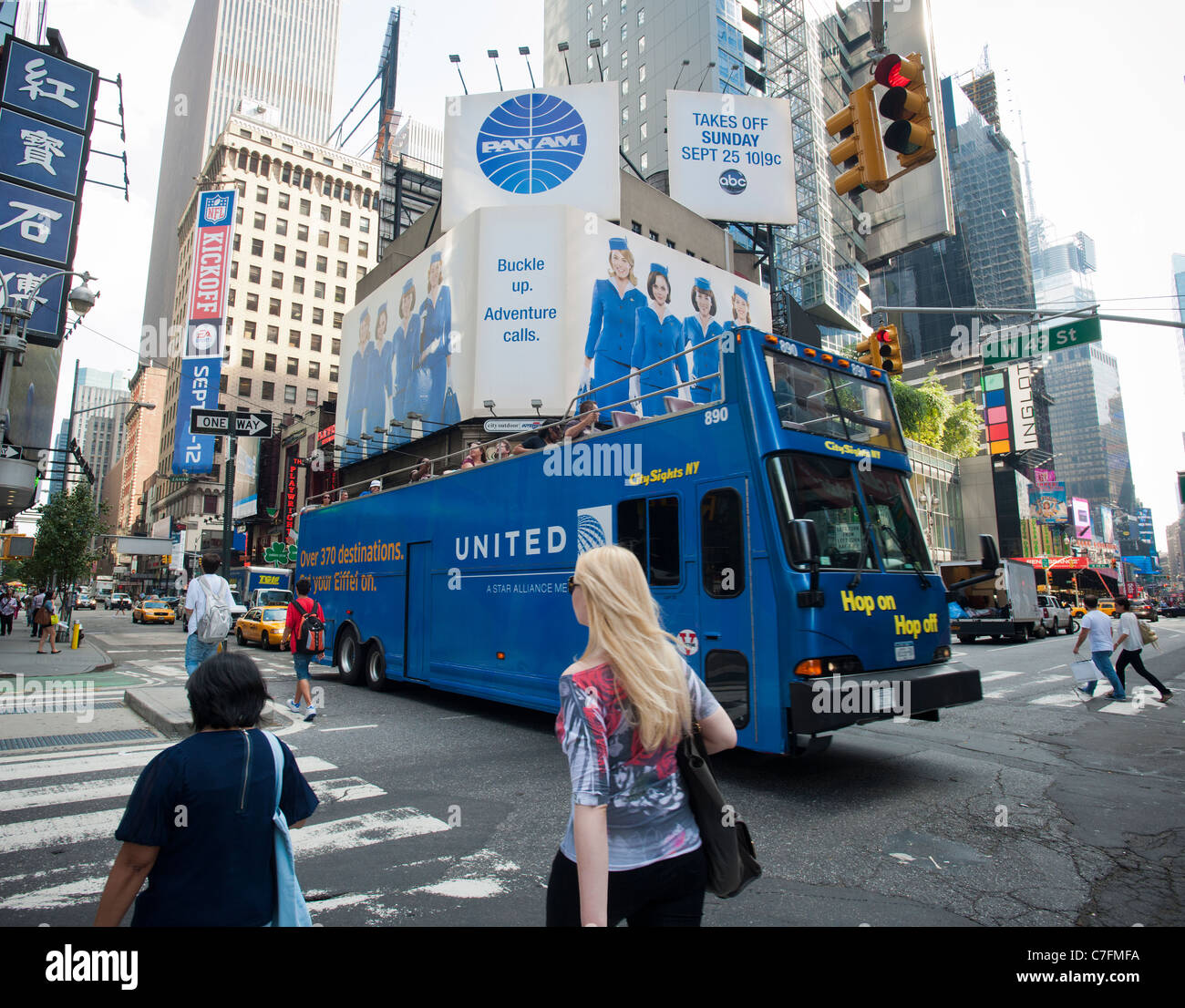 Advertising on billboards in Times Square in New York for the ABC television program, 'Pan Am' - Stock Image