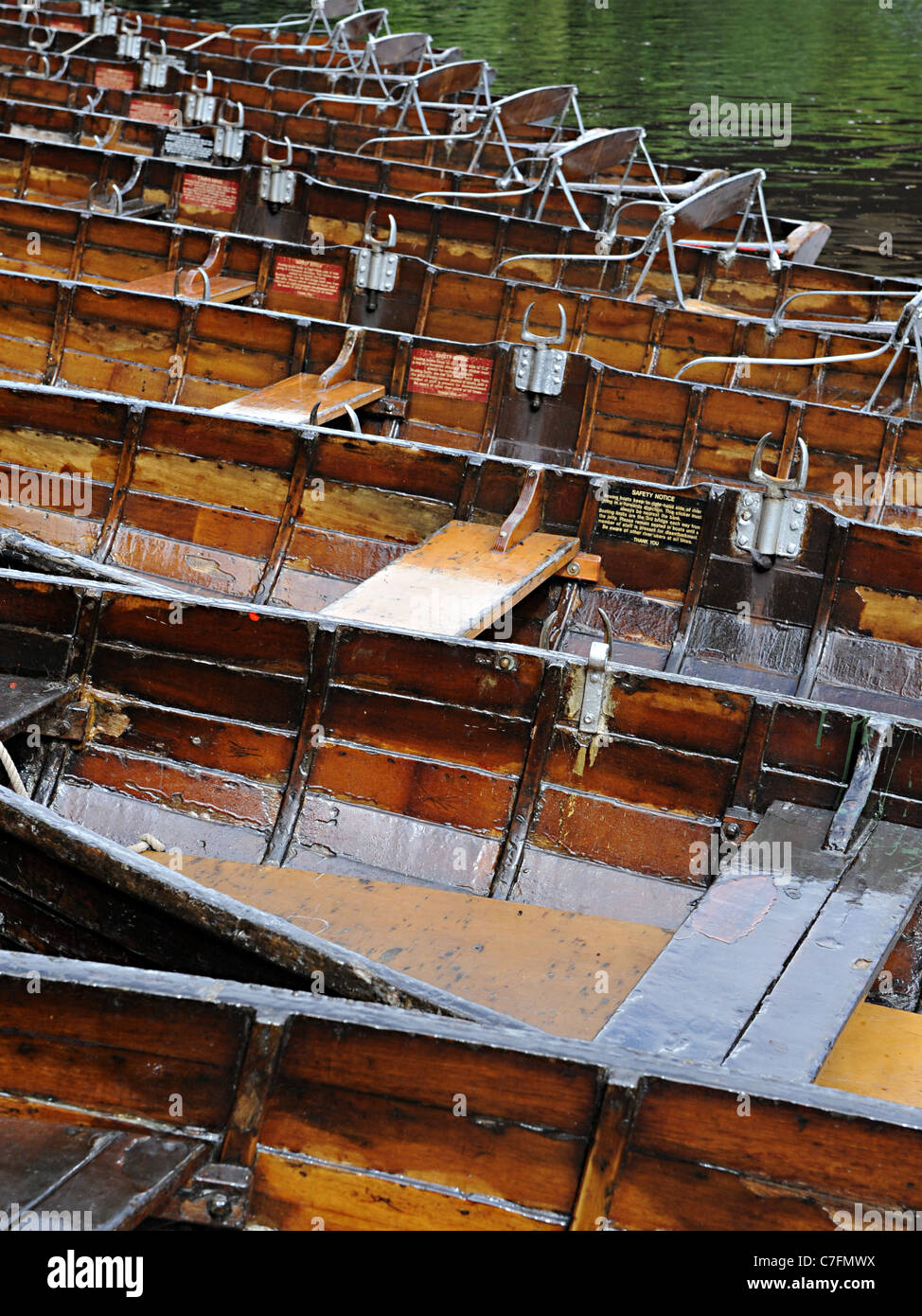 A line of old wooden punts on the river wear in Durham near the Durham University - Stock Image