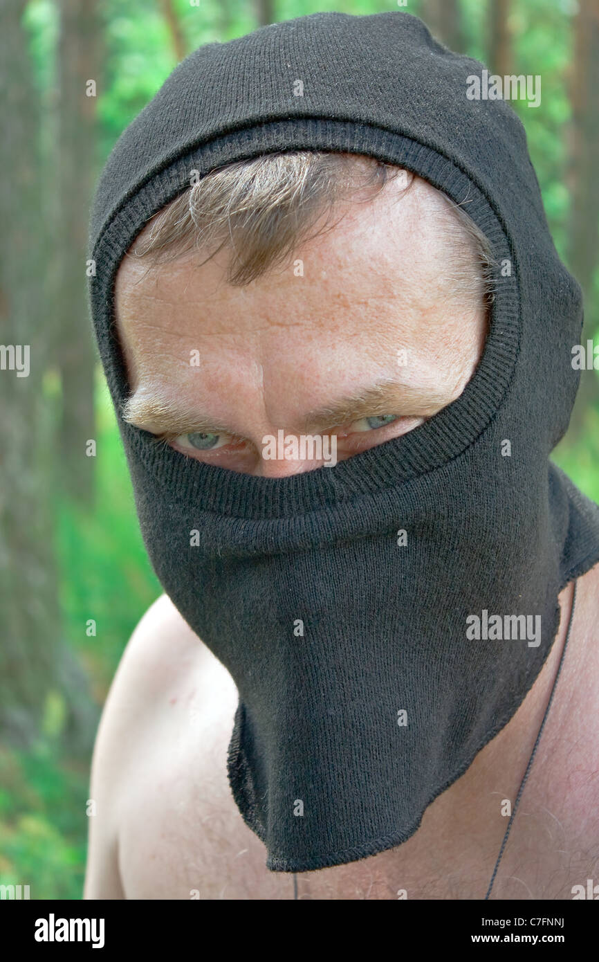 Portrait of the man in black mask looking in lens. - Stock Image