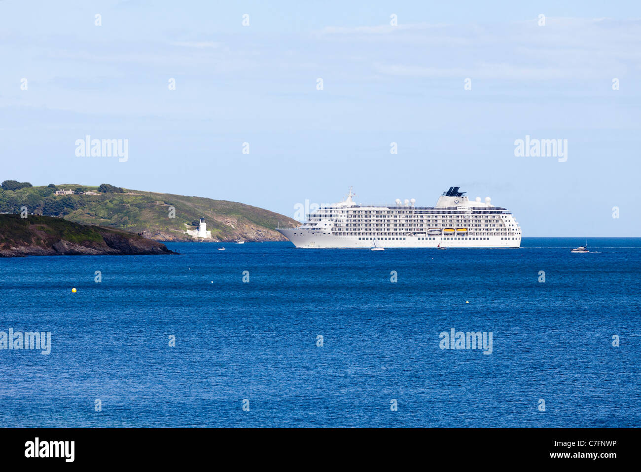 Luxury residential cruise liner 'The World' entering Carrick Roads to dock at Falmouth, Cornwall - Stock Image