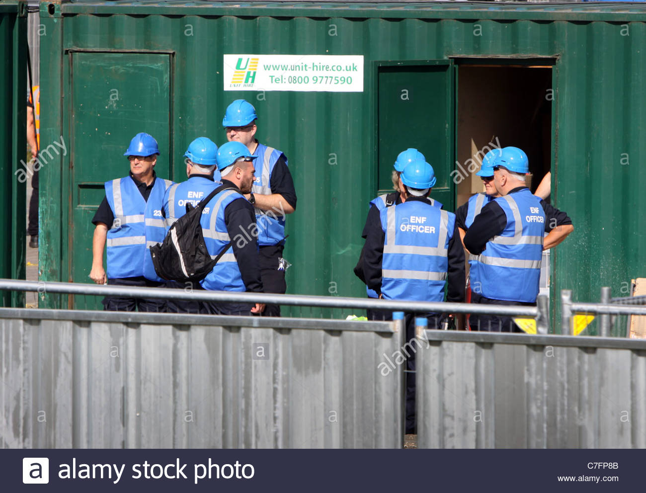 Bailiffs waiting in their compound at Dale Farm travellers site near Basildon Essex - Stock Image