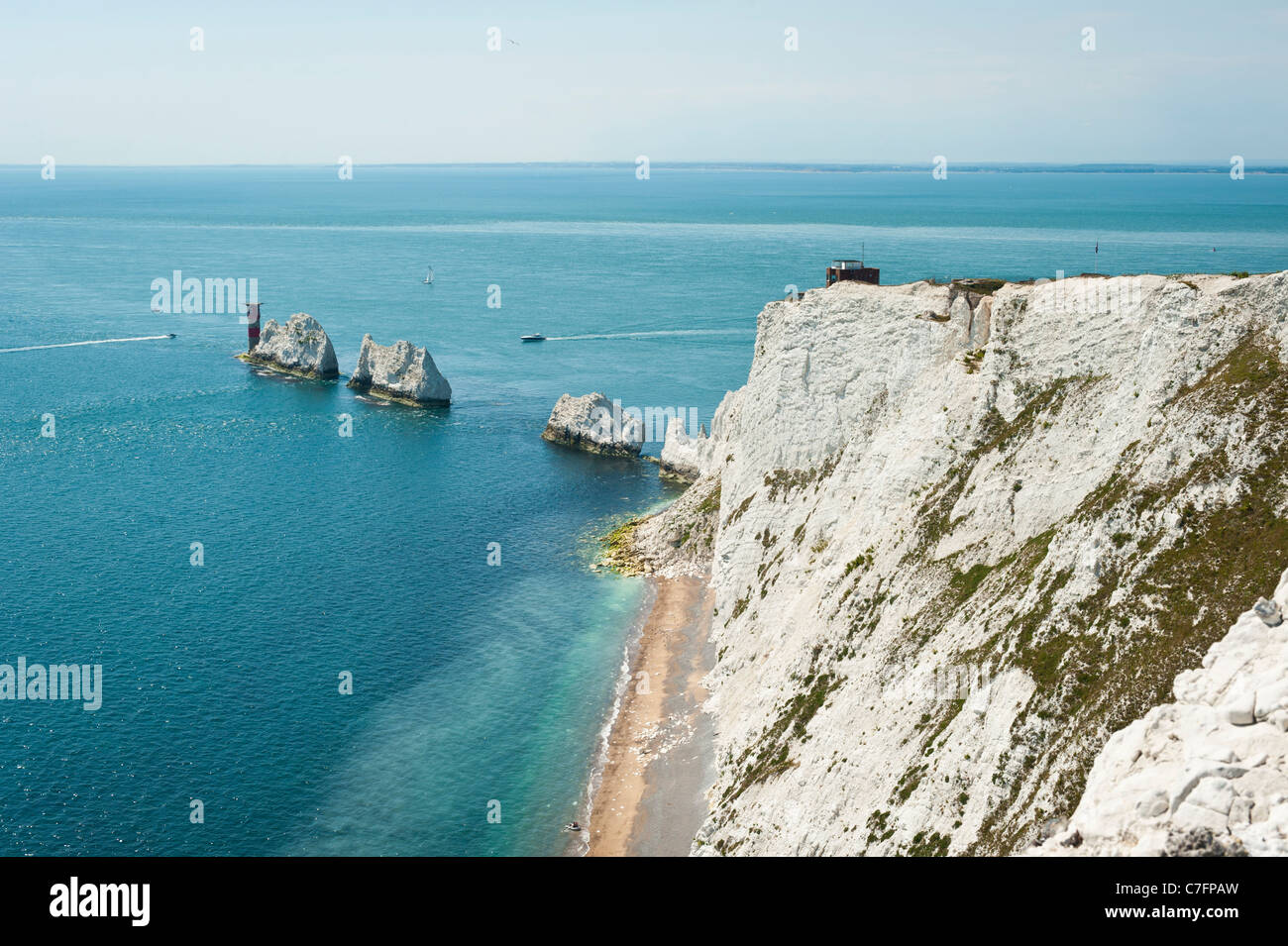 The Needles, lighthouse and chalk cliffs, Isle of Wight, UK - Stock Image