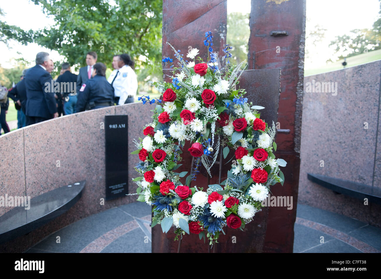 Red white and blue flower arrangement in front of twin towers stock red white and blue flower arrangement in front of twin towers monument at a 911 memorial service at the texas state cemetery izmirmasajfo Gallery