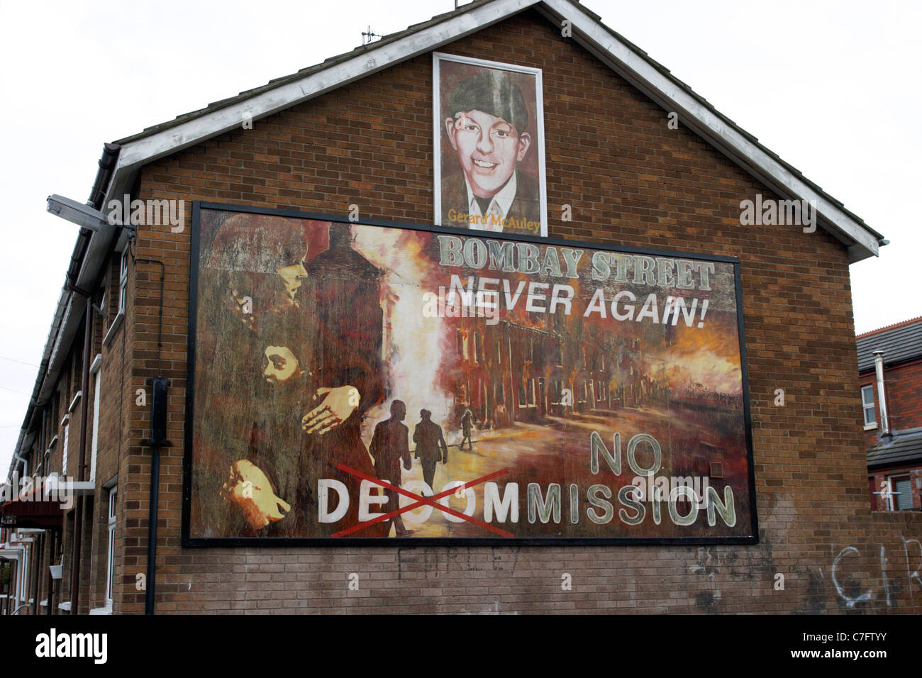 gerard mcauley and bombay street no decomissioning republican wall mural painting west belfast northern ireland - Stock Image