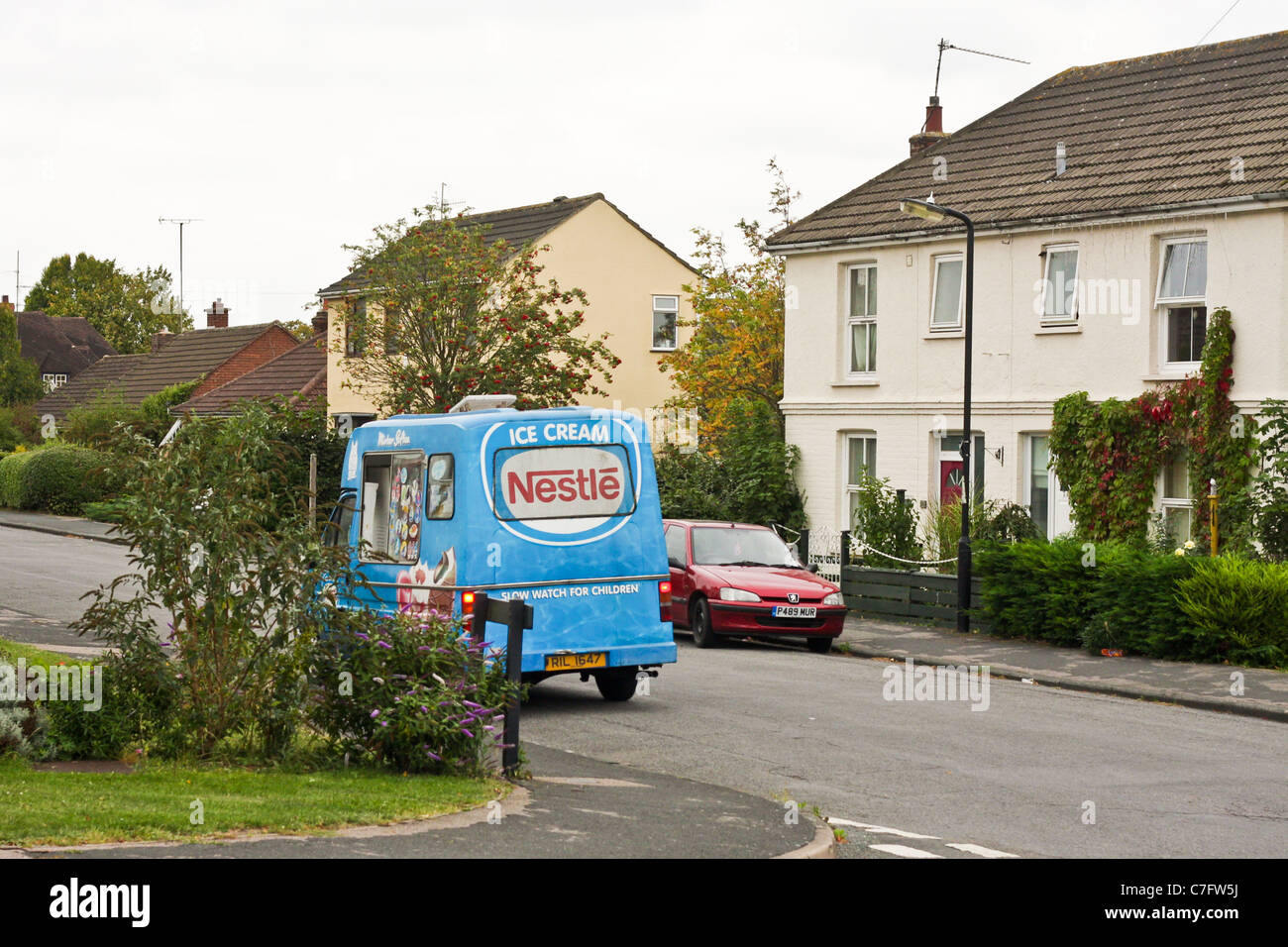 Ice cream van parked on a housing estate in Bury St Edmunds, Suffolk - Stock Image
