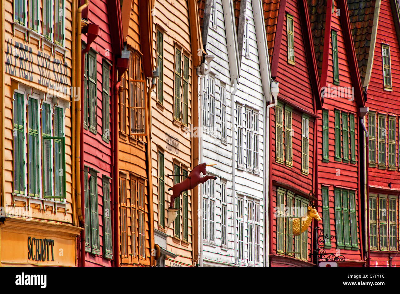 Bergen's old wharf district, Bryggen, wooden warehouse facades in Hanseatic styles & colors - Stock Image