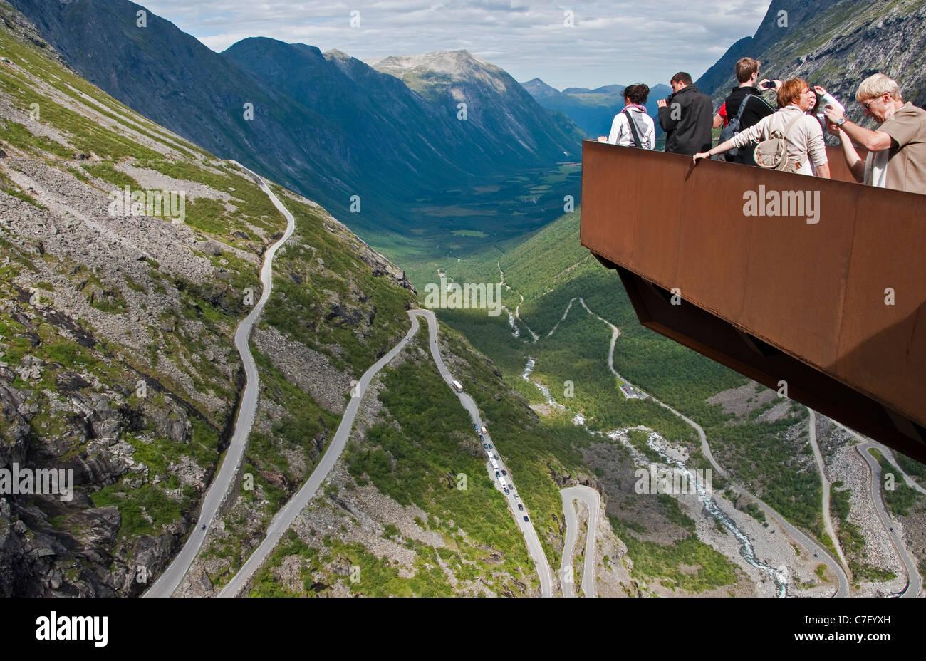 Scenic observation platform overlooking Trollstigen (Troll's Ladder) switchback mountain road in Norway's - Stock Image