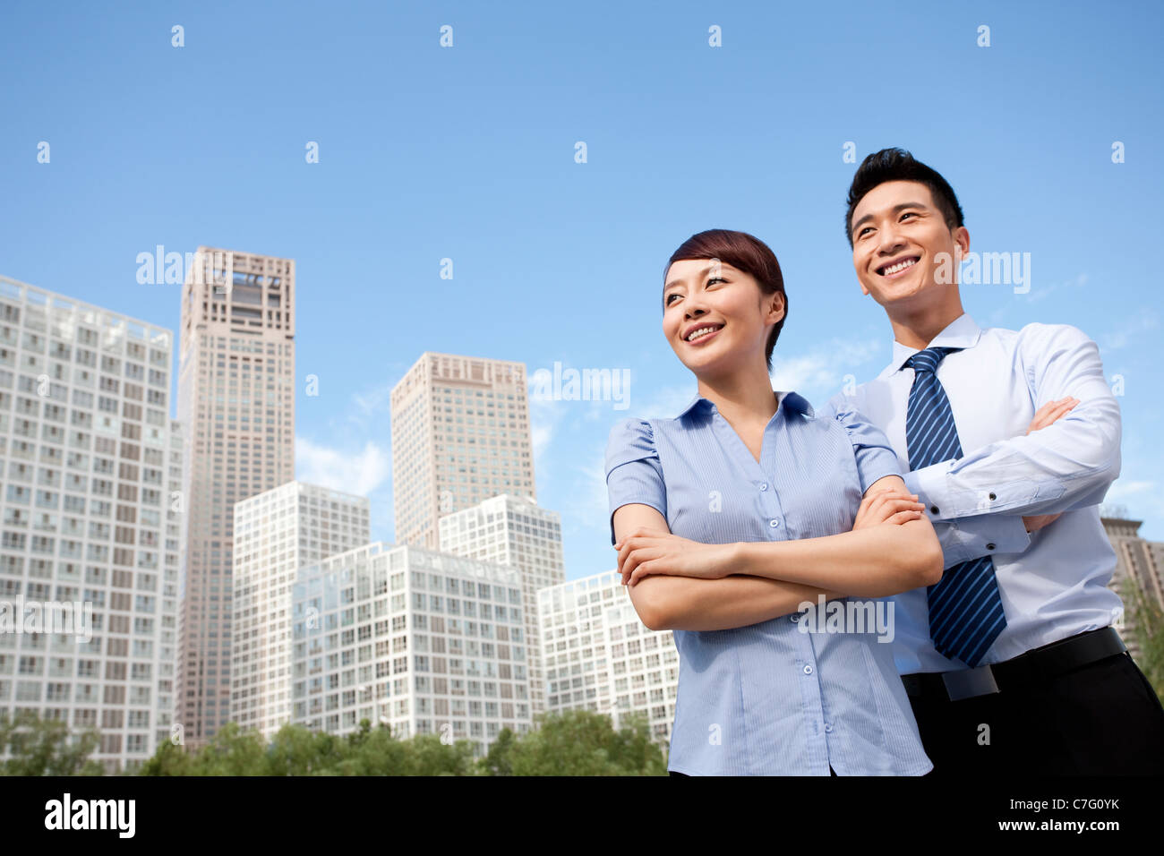 Colleagues Standing Confidently Together Stock Photo