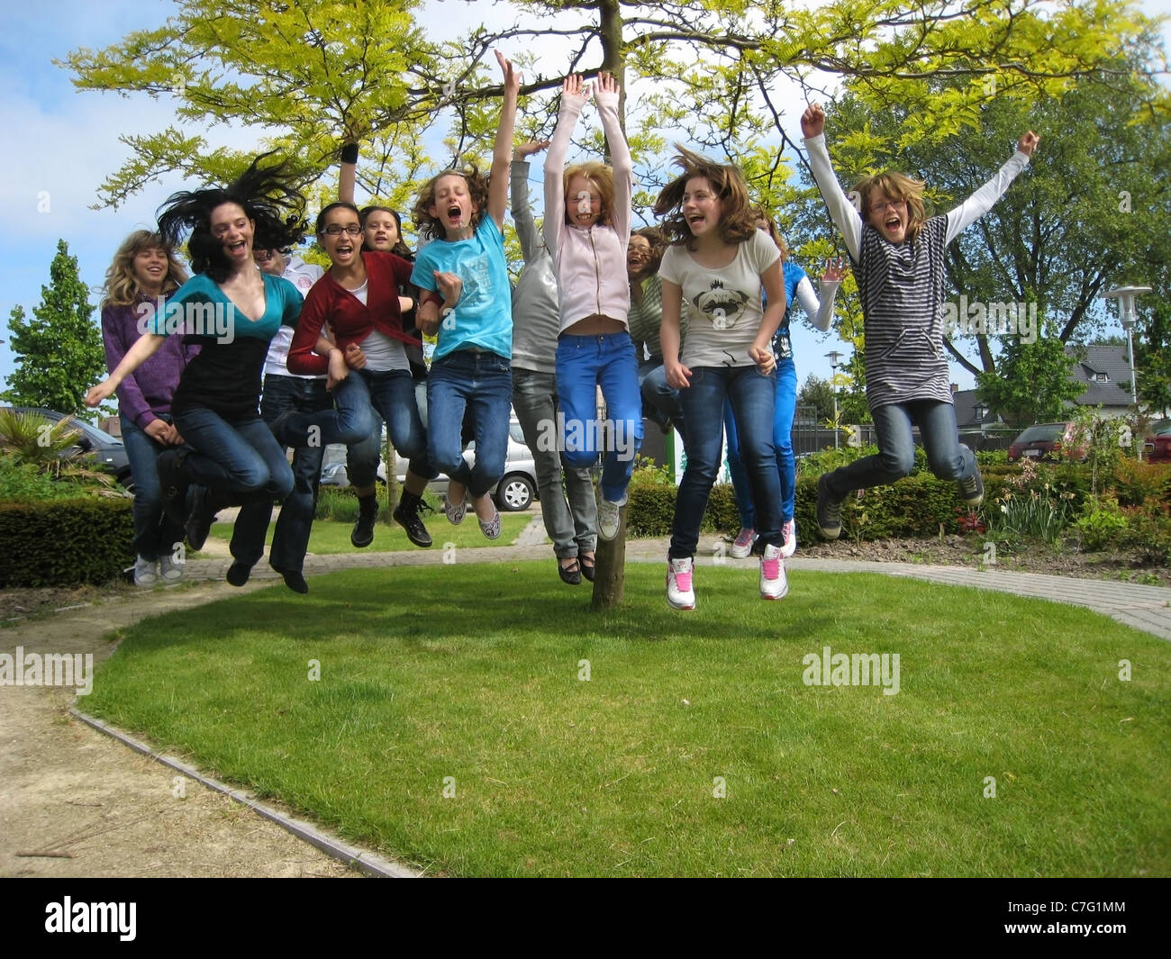 schoolkids jumping - Stock Image