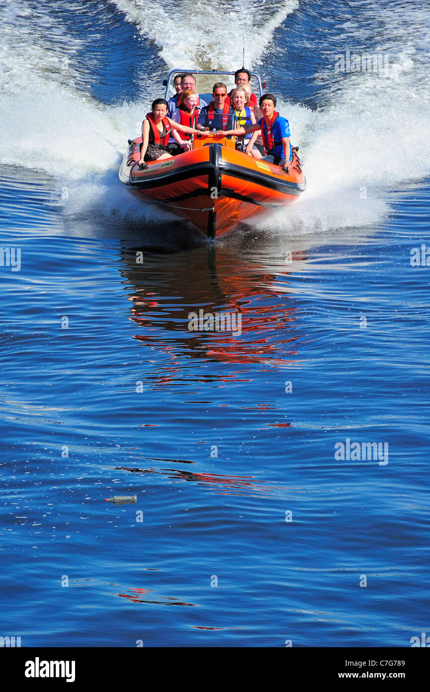 Speedboat on the Clyde (Note bottle floating in water just ahead of the boat). Space for text on water - Stock Image