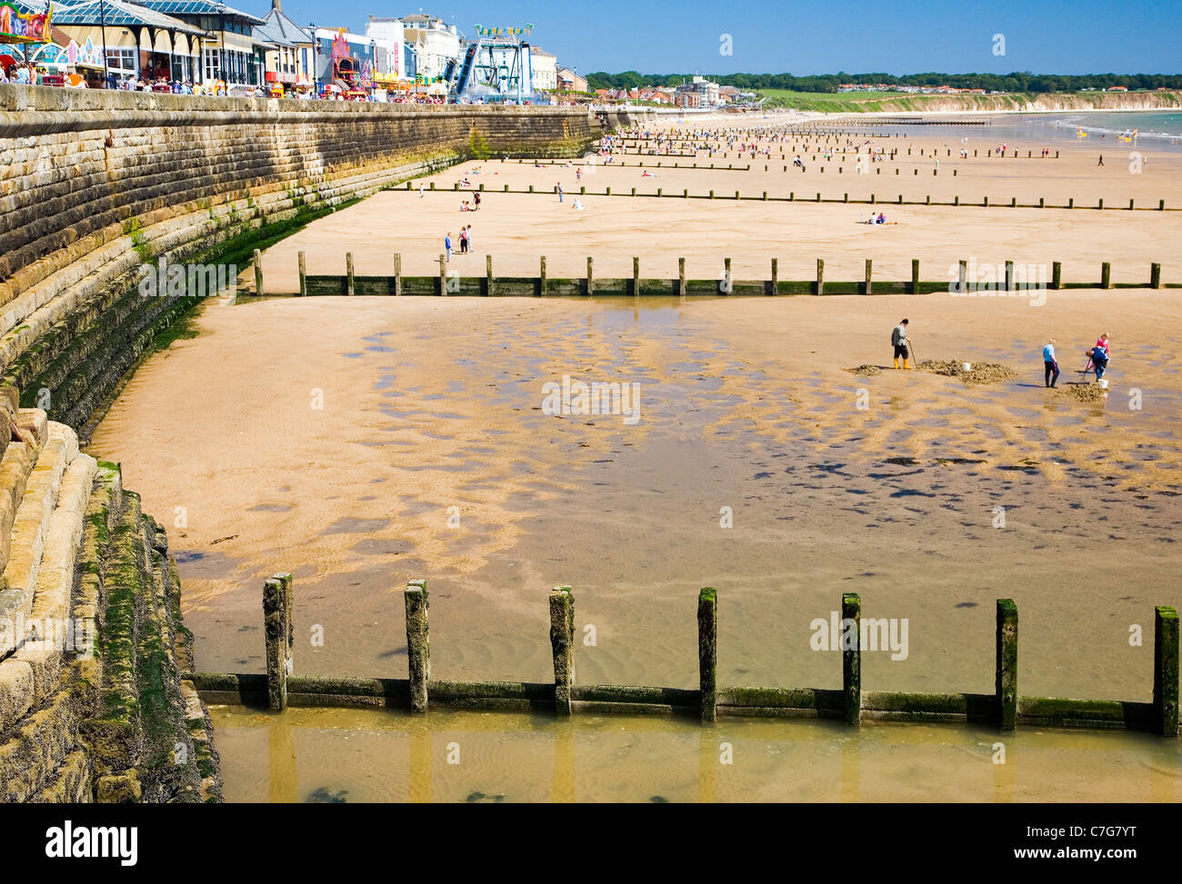 Bridlington beach with groynes and breakwaters on the Yorkshire coast, England - Stock Image