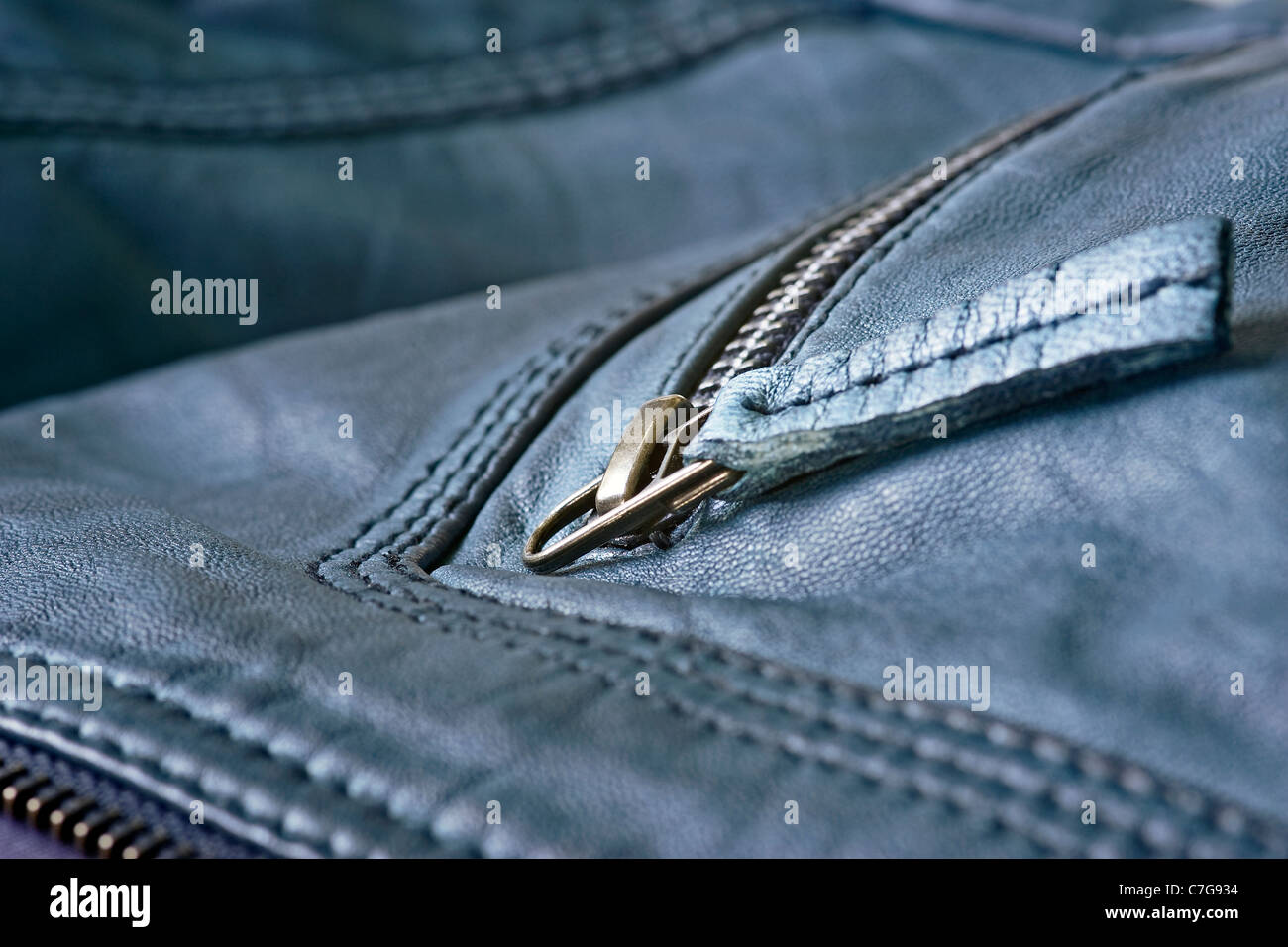 A blue leather jacket with zips. - Stock Image