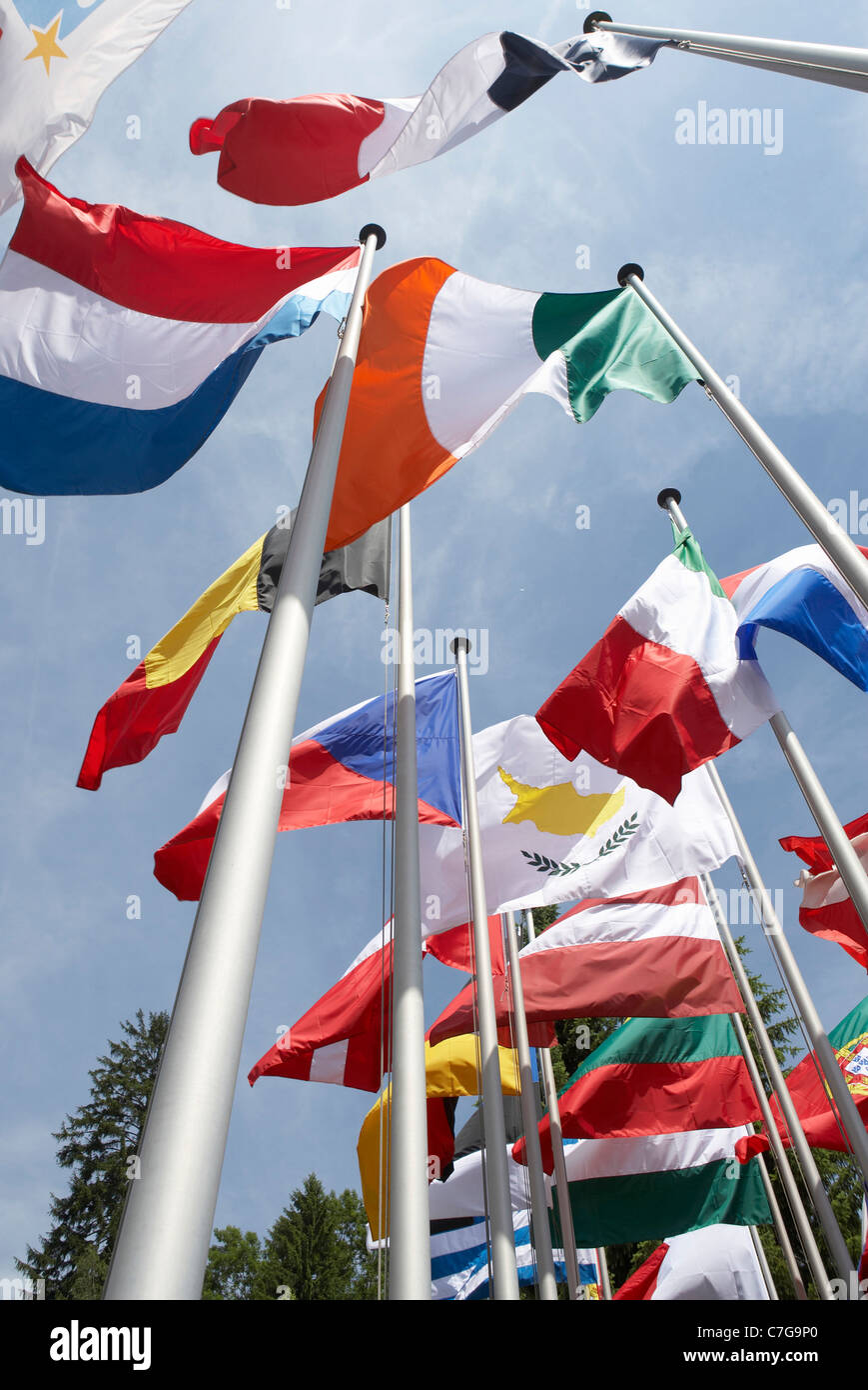 Luxembourg Country. Chateau de Senningen. European flags on Flagpoles. - Stock Image
