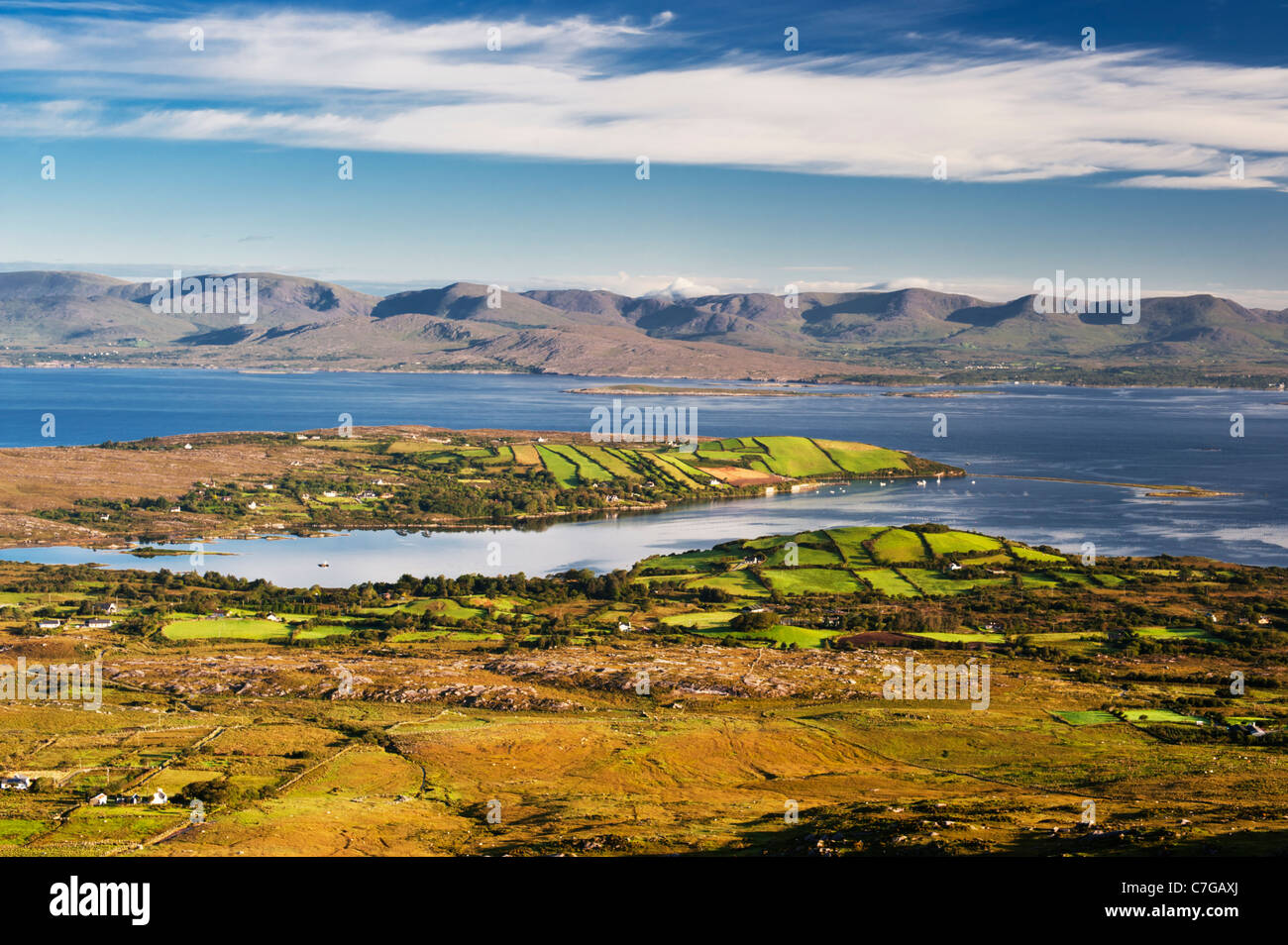 View over Ardgroom, Beara Peninsula, County Cork, Ireland, across Kenmare Bay to the mountains of the Iveragh Peninsula - Stock Image