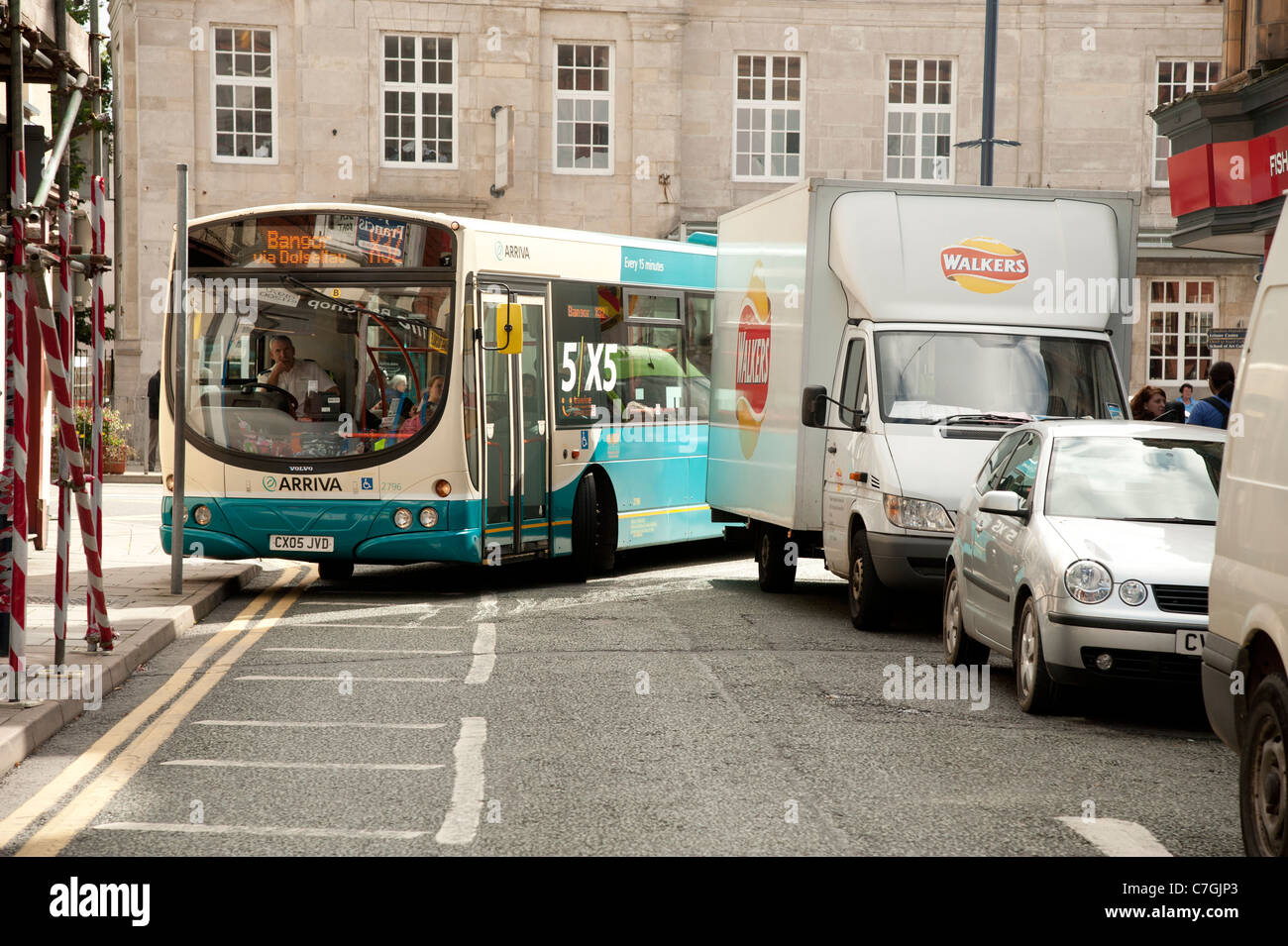An Arriva wales bus unable to turn a corner because of a badly parked delivery van Aberystwyth UK - Stock Image